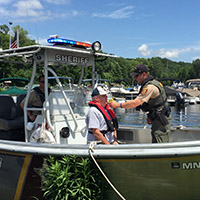 Checking boater with breathalizer - New DWI law now in effect